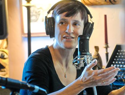 Peri recording a podcast